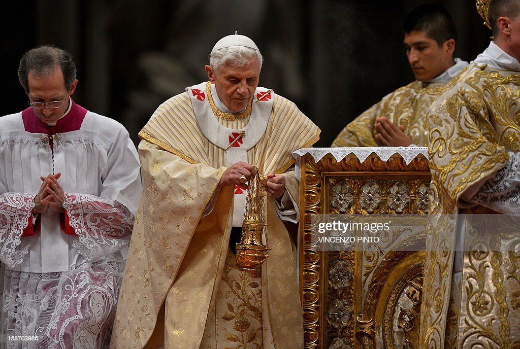 Pope Benedict XVI (C) celebrates a late Christmas night holy mass at St. Peter's Basilica to mark the nativity of Jesus Christ, in Vatican City on December 24, 2012.