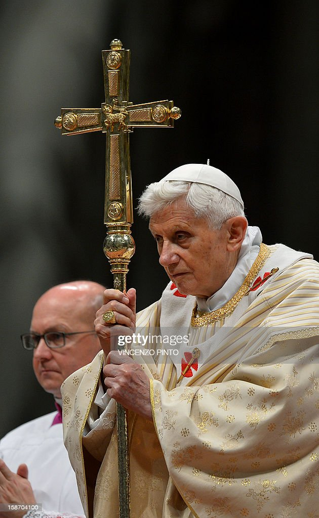 Pope Benedict XVI (R) celebrates Christmas Eve mass at St. Peter's Basilica to mark the nativity of Jesus Christ, in Vatican City on December 24, 2012. Pope Benedict XVI said in his Christmas Eve mass that religion can be corrupted, leading to violence and wars, but refuted critics who claim that denying God's existence would lead to peace.