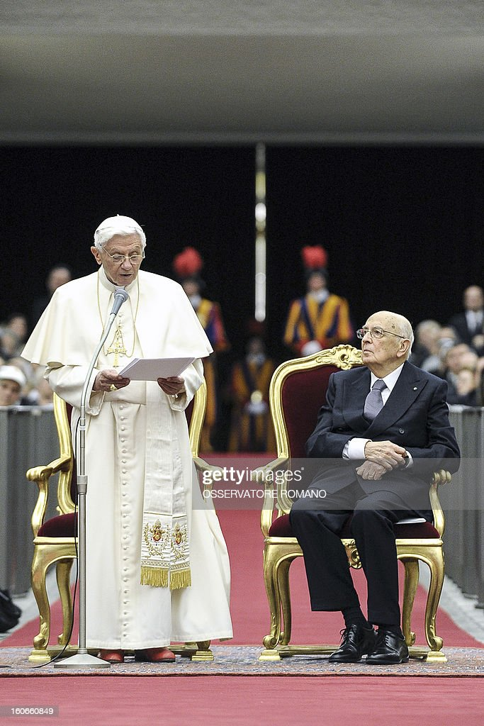 Pope Benedict XVI (L) delivers a speech next to Italy's president Giorgio Napolitano, at the end of a concert by the Orchestra del Maggio Fiorentino, directed by Indian conductor Zubin Metha, to celebrate the 84th Lateran pact's anniversary on February 4, 2013, at the Sala Nervi in Vatican city. AFP PHOTO / HO / OSSERVATORE ROMANO