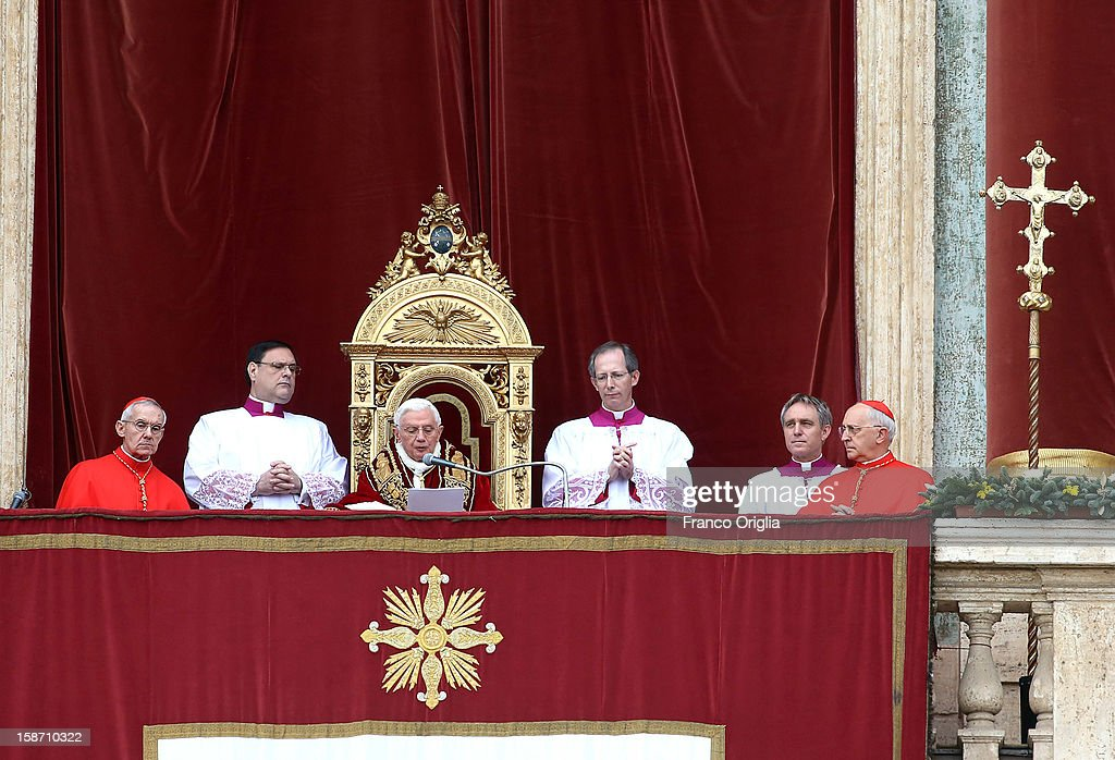 <a gi-track='captionPersonalityLinkClicked' href=/galleries/search?phrase=Pope+Benedict+XVI&family=editorial&specificpeople=201771 ng-click='$event.stopPropagation()'>Pope Benedict XVI</a> delivers his Christmas Day message to the faithful from the central balcony of St Peter's Basilica on December 25, 2012 in Vatican City, Vatican. The 'Urbi et Orbi' (to the city and to the world) is recognised as a Christmas tradition by Catholics with the Pope focusing this year on the conflict in Syria, calling for a political solution.