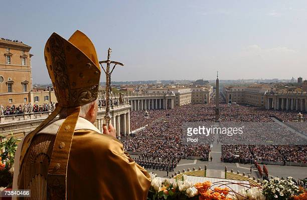Pope Benedict XVI delivers his Urbi et Orbi blessing from the central Loggia of St Peter's Basilica at the end of the Easter Sunday Mass on April 8...