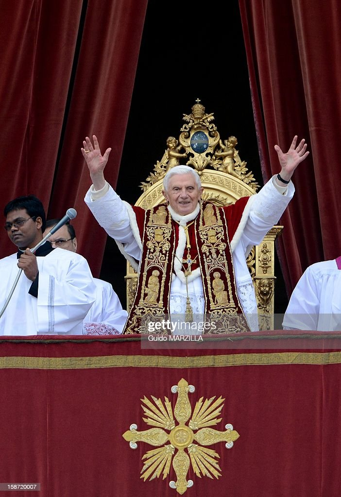 <a gi-track='captionPersonalityLinkClicked' href=/galleries/search?phrase=Pope+Benedict+XVI&family=editorial&specificpeople=201771 ng-click='$event.stopPropagation()'>Pope Benedict XVI</a> delivers his 'Urbi et Orbi' (to the City and to the World) Christmas message from the central loggia of St. Peter's Basilica on December 25, 2012 at the Vatican. <a gi-track='captionPersonalityLinkClicked' href=/galleries/search?phrase=Pope+Benedict+XVI&family=editorial&specificpeople=201771 ng-click='$event.stopPropagation()'>Pope Benedict XVI</a> wished Christmas peace to the world, decrying the slaughter of the 'defenseless' in Syria and urging Israelis and Palestinians to find the courage to negociate.