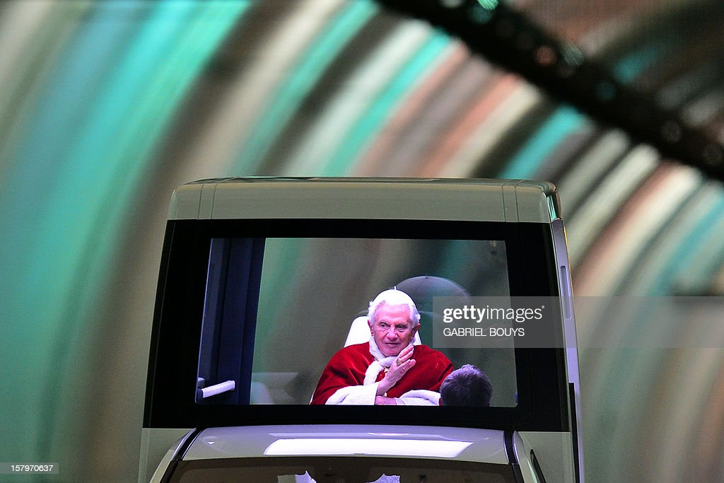 Pope Benedict XVI drives through a tunnel as he leaves in his 'popemobile' after a prayer at the statue of virgin Mary during the annual feast of the Immaculate Conception at Piazza di Spagna (Spanish Steps) in Rome on December 8, 2012 on the day dedicated to virgin Mary.