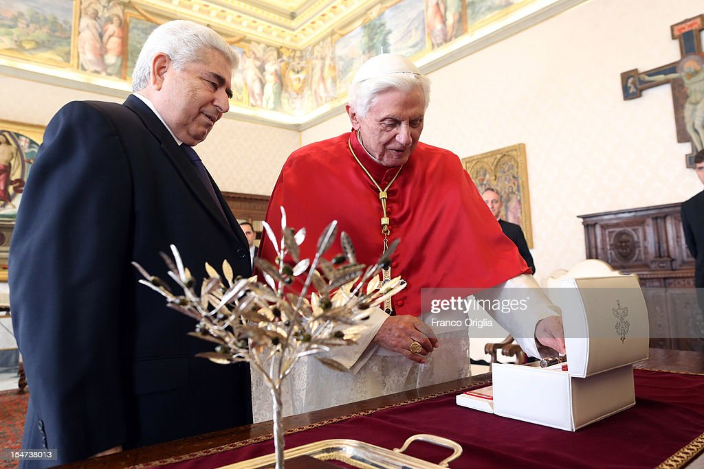 <a gi-track='captionPersonalityLinkClicked' href=/galleries/search?phrase=Pope+Benedict+XVI&family=editorial&specificpeople=201771 ng-click='$event.stopPropagation()'>Pope Benedict XVI</a> (R) exchanges gifts with Cyprus President Demetris Christofias (L) during a meeting at his private studio on October 25, 2012 in Vatican City, Vatican. The President and his wife are on a one day official visit to the Vatican.