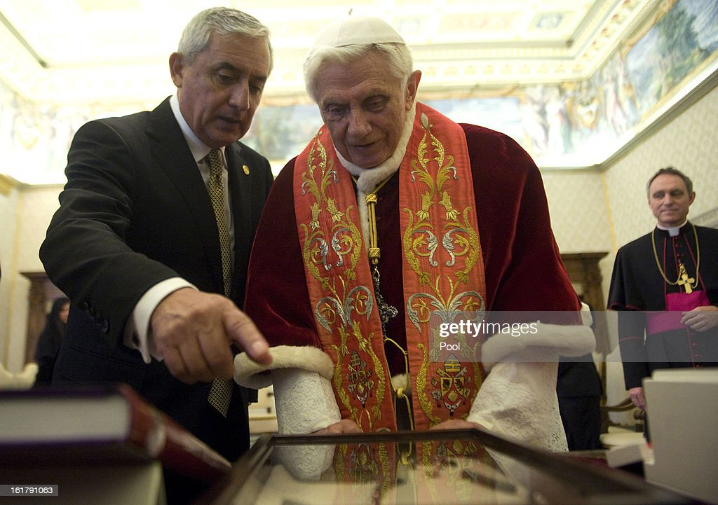 Pope Benedict XVI exchanges gifts with Guatemala's President <a gi-track='captionPersonalityLinkClicked' href=/galleries/search?phrase=Otto+Perez+Molina&family=editorial&specificpeople=800118 ng-click='$event.stopPropagation()'>Otto Perez Molina</a> during a private audience at his private library on February 16, 2013 in Vatican City, Vatican.