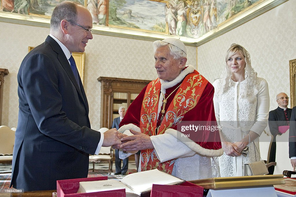 Pope Benedict XVI exchanges gifts with HSH <a gi-track='captionPersonalityLinkClicked' href=/galleries/search?phrase=Prince+Albert+II+of+Monaco&family=editorial&specificpeople=201707 ng-click='$event.stopPropagation()'>Prince Albert II of Monaco</a> and HSH Princess <a gi-track='captionPersonalityLinkClicked' href=/galleries/search?phrase=Charlene+-+Princess+of+Monaco&family=editorial&specificpeople=726115 ng-click='$event.stopPropagation()'>Charlene</a> of Monaco during a private audience at his library on January 12, 2013 in Vatican City, Vatican.