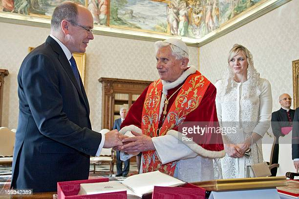 Pope Benedict XVI exchanges gifts with HSH Prince Albert II of Monaco and HSH Princess Charlene of Monaco during a private audience at his library on...