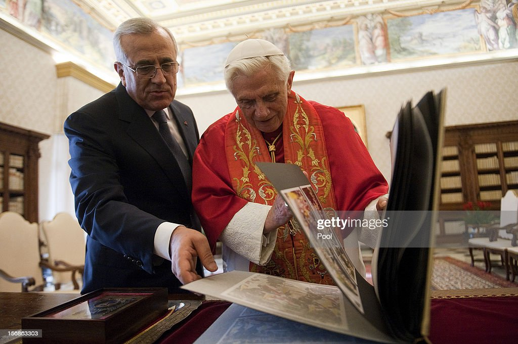 Pope Benedict XVI exchanges gifts with Lebanon President <a gi-track='captionPersonalityLinkClicked' href=/galleries/search?phrase=Michel+Sleiman&family=editorial&specificpeople=2069358 ng-click='$event.stopPropagation()'>Michel Sleiman</a> during a meeting at his private library on November 23, 2012 in Vatican City, Vatican. The meeting comes ahead of the nomination of a new Lebanese cardinal, a move considered by observers as a sign of Vatican support for religious diversity in Lebanon.