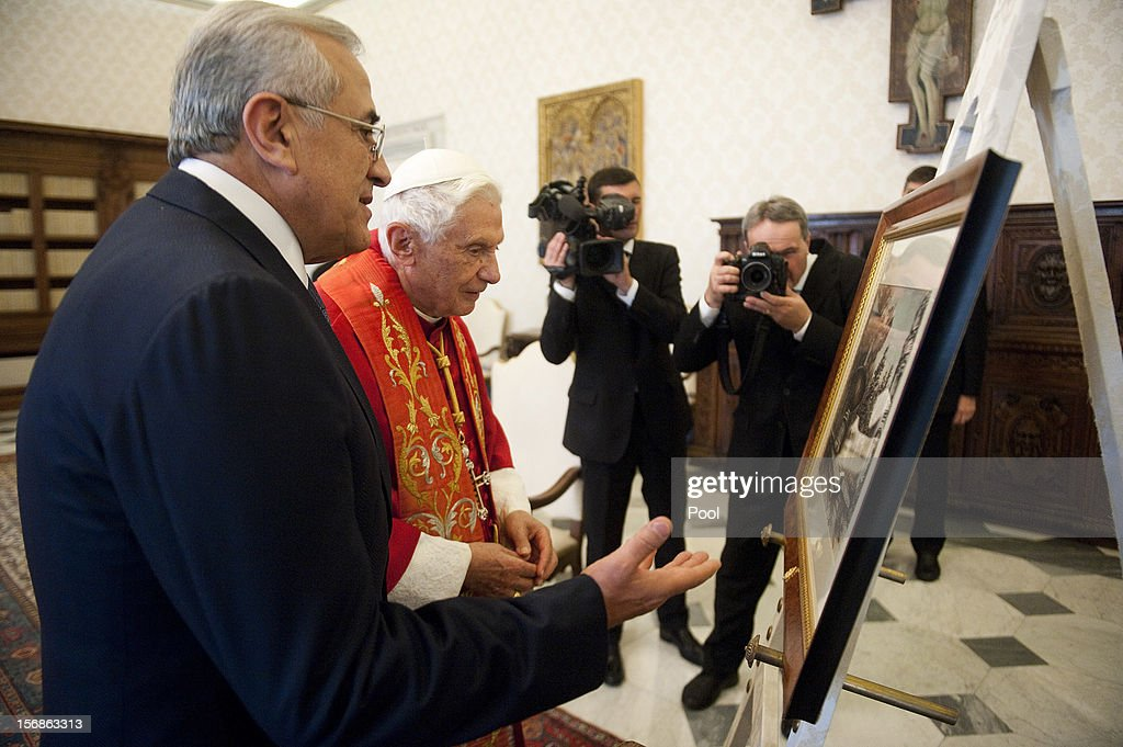 <a gi-track='captionPersonalityLinkClicked' href=/galleries/search?phrase=Pope+Benedict+XVI&family=editorial&specificpeople=201771 ng-click='$event.stopPropagation()'>Pope Benedict XVI</a> exchanges gifts with Lebanon President <a gi-track='captionPersonalityLinkClicked' href=/galleries/search?phrase=Michel+Sleiman&family=editorial&specificpeople=2069358 ng-click='$event.stopPropagation()'>Michel Sleiman</a> during a meeting at his private library on November 23, 2012 in Vatican City, Vatican. The meeting comes ahead of the nomination of a new Lebanese cardinal, a move considered by observers as a sign of Vatican support for religious diversity in Lebanon.