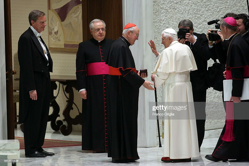 Pope Benedict XVI, flanked by cardinal Agostino Vallini, leaves the Paul VI Hall at the end of a meeting with parish priests of Rome's diocese on February 14, 2013 in Vatican City, Vatican. The Pontiff will hold his last weekly public audience on February 27 at St Peter's Square after announcing his resignation earlier this week.