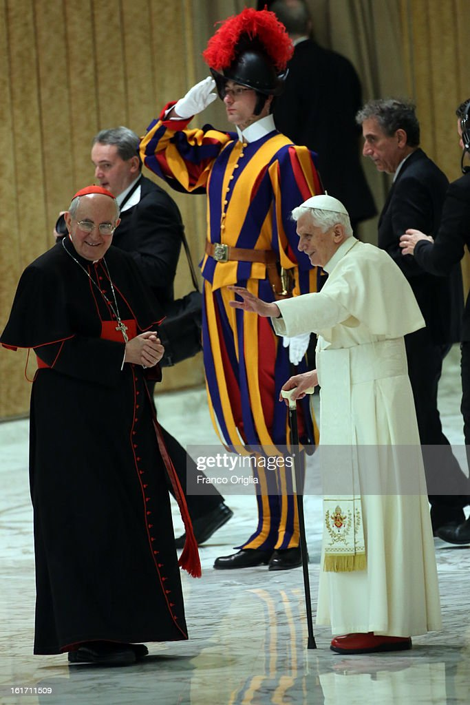 Pope Benedict XVI, flanked by cardinal Agostino Vallini (L), leaves the Paul VI Hall at the end of a meeting with parish priests of Rome's diocese on February 14, 2013 in Vatican City, Vatican. The Pontiff will hold his last weekly public audience on February 27 at St Peter's Square after announcing his resignation earlier this week.