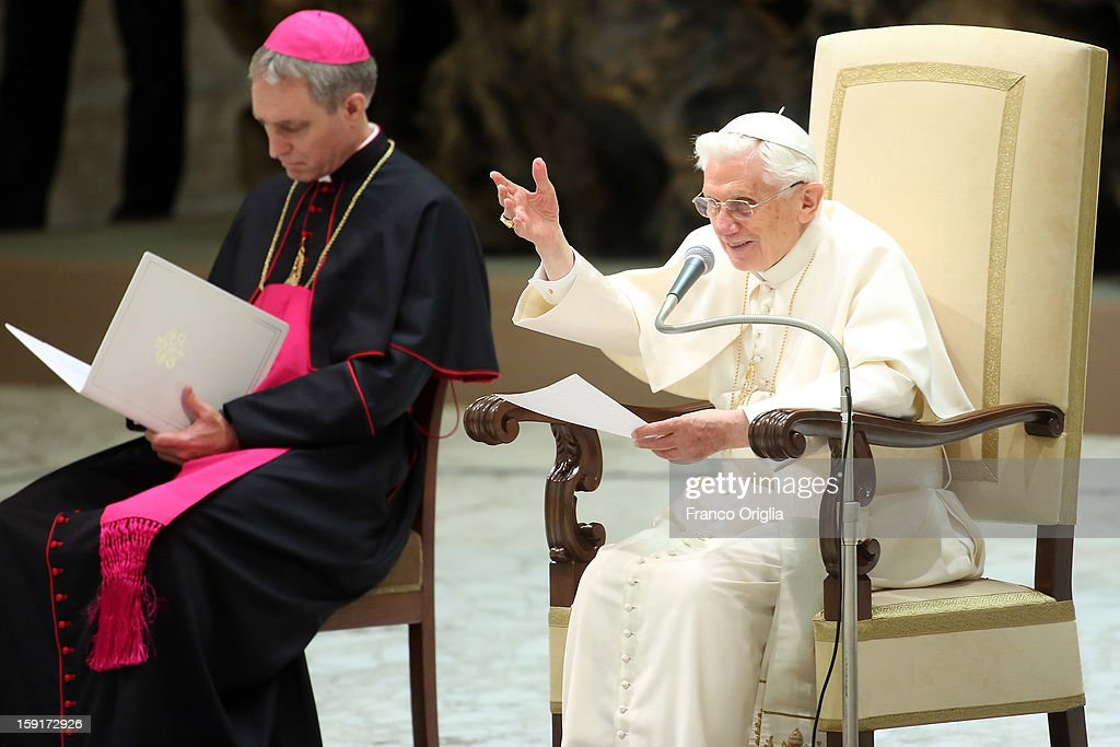 Pope Benedict XVI (R), flanked by his personal secretary <a gi-track='captionPersonalityLinkClicked' href=/galleries/search?phrase=Georg+Gaenswein&family=editorial&specificpeople=612800 ng-click='$event.stopPropagation()'>Georg Gaenswein</a> (L), waves to the faithful gathered at the Paul VI Hall during his weekly audience on January 9, 2013 in Vatican City, Vatican. The Pontiff gave the catechesis dedicated to the Year of Faith, during his regularly scheduled Wednesday general audience.