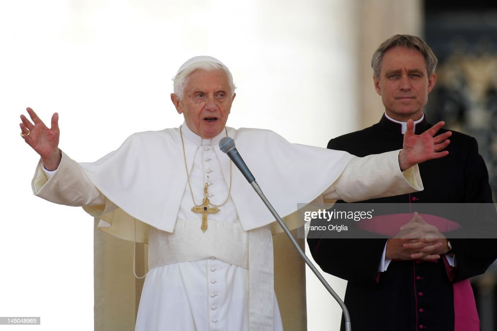 <a gi-track='captionPersonalityLinkClicked' href=/galleries/search?phrase=Pope+Benedict+XVI&family=editorial&specificpeople=201771 ng-click='$event.stopPropagation()'>Pope Benedict XVI</a>, flanked by his personal secretary Georg Ganswein (R), blesses faithful gathered in St. Peter's Square during his weekly audience on May 23, 2012 in Vatican City, Vatican. Pontiff will visit Milan for a three-day family meeting on 30 May-3 June.