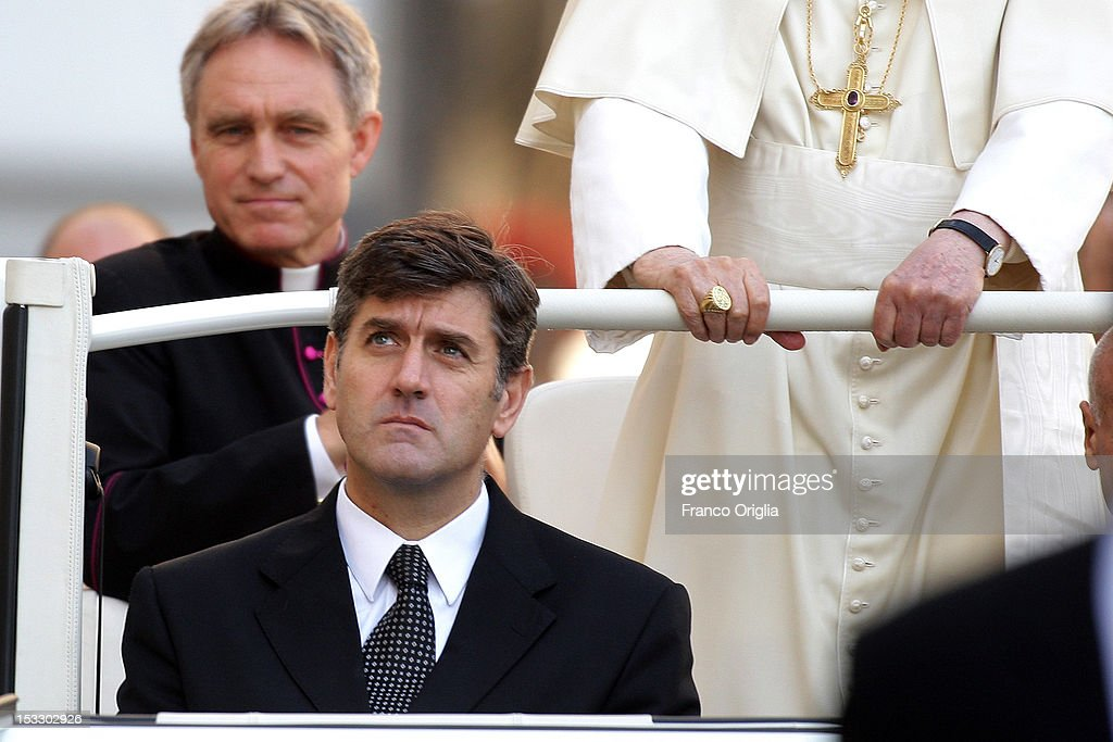 Pope Benedict XVI (R) flanked by his personal secretary Georg Ganswein (L) and his new butler Sandro Mariotti (C) arrives on popemobile in St. Peter's square for his weekly audience on October 3, 2012 in Vatican City, Vatican. The trial of the Pope's former butler Paolo Gabriele, accused of passing private documents from Benedict XVI to a journalist, continues today in the Vatican courtroom. During the Pope's weekly audience, Italian businessman Marcello Di Finizio also staged a protest on the dome of St Peter's Basilica in repsonse to an EU directive to auction off licenses to operate along sections of Italy's seafront, a move which he believes will favour multinationals to the detriment of local businesses.