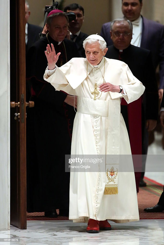 <a gi-track='captionPersonalityLinkClicked' href=/galleries/search?phrase=Pope+Benedict+XVI&family=editorial&specificpeople=201771 ng-click='$event.stopPropagation()'>Pope Benedict XVI</a>, flanked by his personal secretary Georg Ganswein (L), waves to the faithful as he arrives at the Paul VI Hall for his weekly audience on February 13, 2013 in Vatican City, Vatican. The Pontiff will hold his last weekly public audience on February 27 at St Peter's Square after announcing his resignation earlier this week.