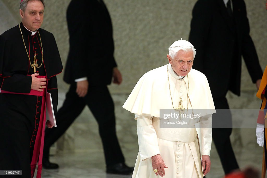 Pope Benedict XVI (R) flanked by his personal secretary Georg Ganswein (L), arrives at the Paul VI Hall for his weekly audience on February 13, 2013 in Vatican City, Vatican. The Pontiff will hold his last weekly public audience on February 27 at St Peter's Square after announcing his resignation earlier this week.