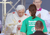Pope Benedict XVI gives communion while leading a morning mass at Domplatz square in front of the Erfurter Dom cathedral on September 24 2011 in...