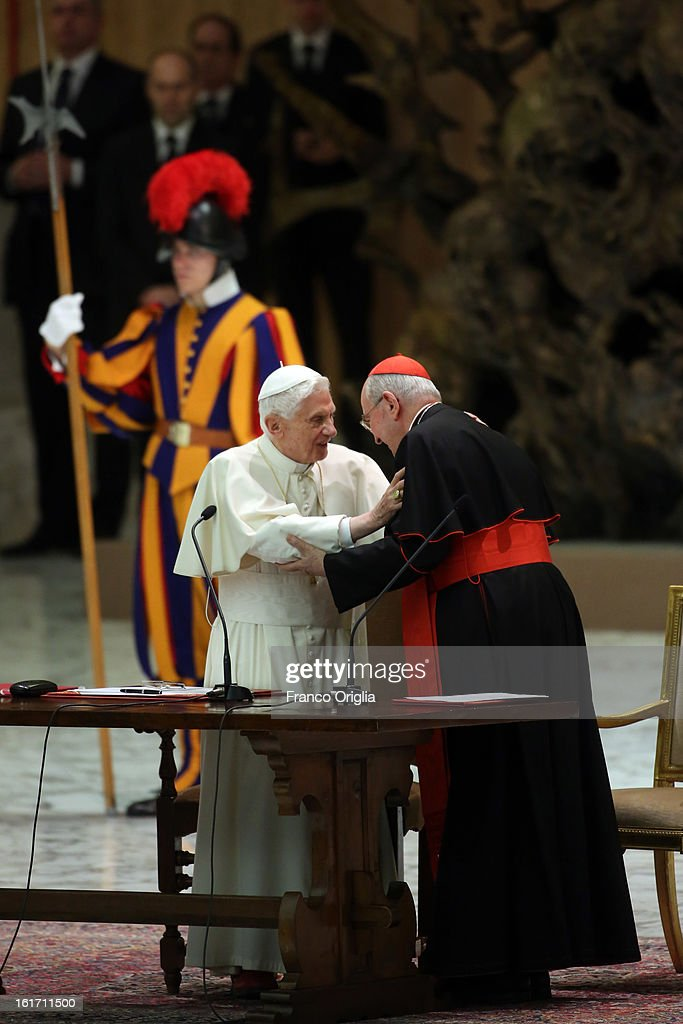 Pope Benedict XVI greets cardinal Agostino Vallini (R), as he attends a meeting with parish priests of Rome's diocese at the Paul VI Hall on February 14, 2013 in Vatican City, Vatican. The Pontiff will hold his last weekly public audience on February 27 at St Peter's Square after announcing his resignation earlier this week.