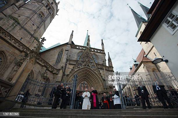 Pope Benedict XVI greets pilgrims outside the Dom cathedral next to Bishop Joachim Wanke on September 23 2011 in Erfurt Germany The Pope is in Erfurt...