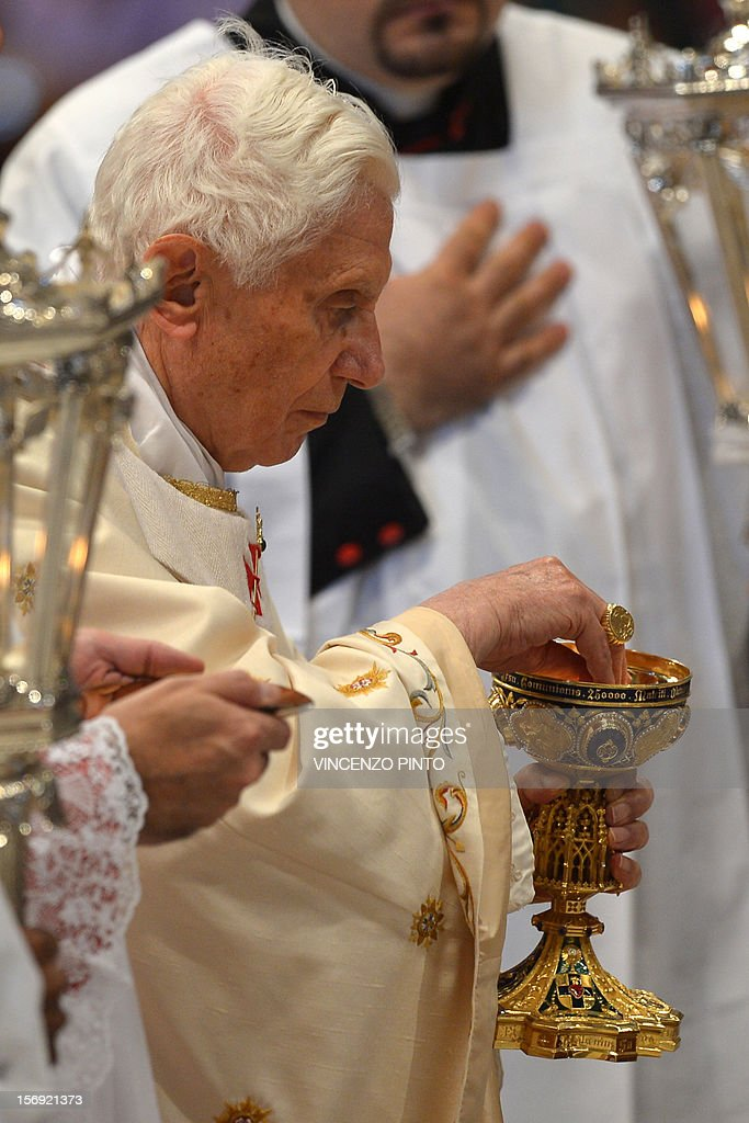 Pope Benedict XVI holds the chalice during a Holy mass with new cardinals on November 25, 2012 at St Peter's basilica at the Vatican. Pope Benedict XVI the day before consecrated six non-European prelates as new members of the College of Cardinals in a development welcomed by critics concerned that the body which will elect the future pope is too Euro-centric. AFP PHOTO / VINCENZO PINTO