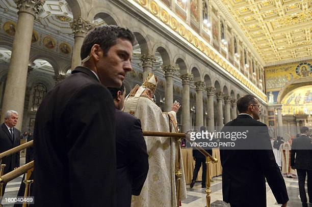 Pope Benedict XVI is escorted by bodyguards as he arrives to lead the celebration of the Vespers of the Solemnity of the conversion of Saint Paul in...