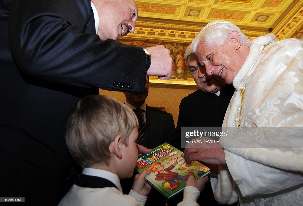 Pope Benedict XVI is handed a children's book by Nikolai son of Belarus President Alexander Lukashenko Pope Benedict XVI met Belarus President...