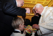 Pope Benedict XVI is handed a children's book by Nikolai son of Belarus President Alexander Lukashenko Pope Benedict XVI met Belarus President...
