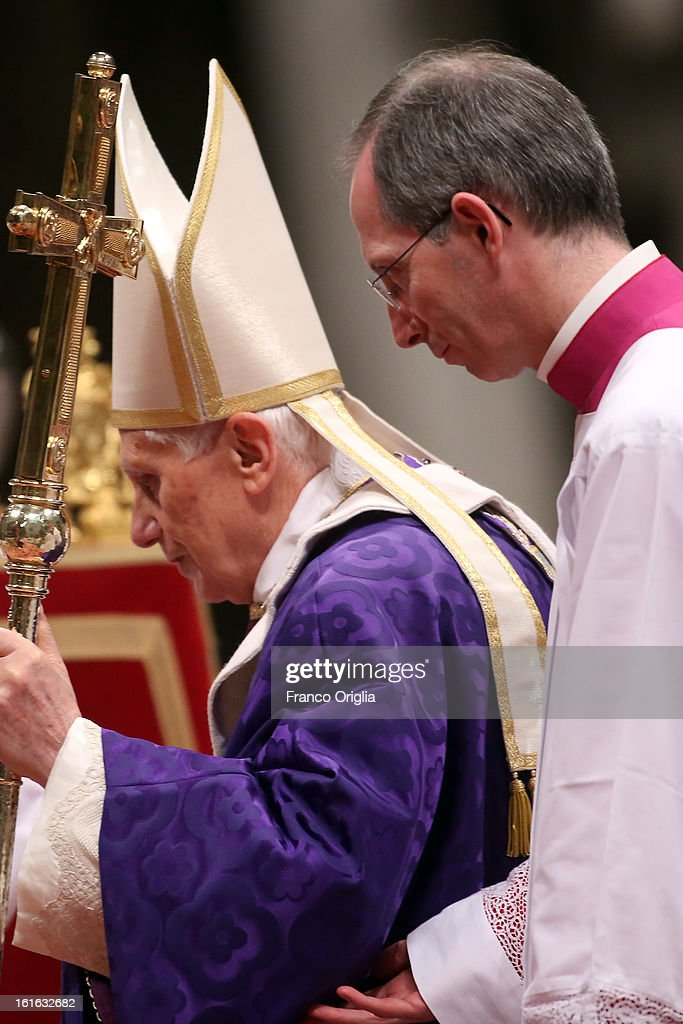Pope Benedict XVI is helped as he leads the Ash Wednesday service at the St. Peter's Basilica on February 13, 2013 in Vatican City, Vatican. Ash Wednesday opens the liturgical 40-day period of Lent, a time of prayer, fasting, penitence and alms giving leading up to Easter.