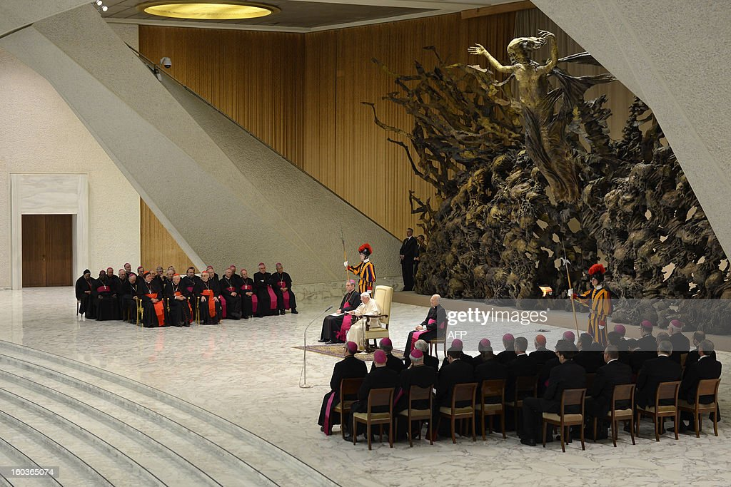 Pope Benedict XVI (C) leads his weekly general audience on January 30, 2013 at the Paul VI hall at the Vatican. AFP PHOTO / ANDREAS SOLARO