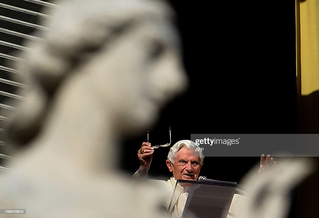 Pope Benedict XVI leads the Angelus prayer from a window of his apartments on December 9, 2012 at the Vatican. AFP PHOTO / ALBERTO PIZZOLI