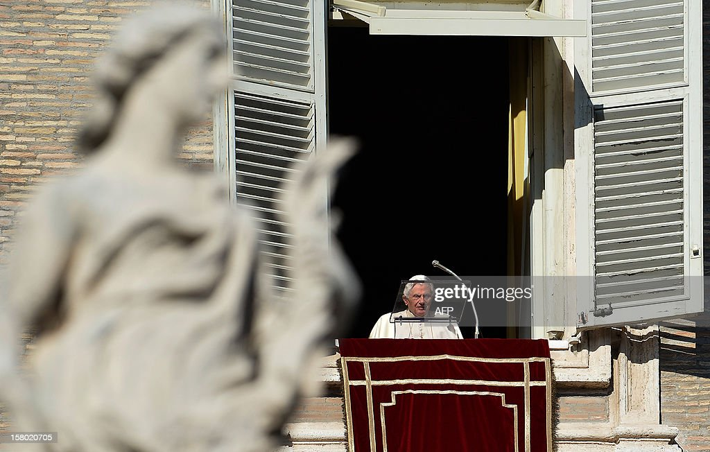 Pope Benedict XVI leads the Angelus prayer from a window of his apartments on December 9, 2012 at the Vatican.