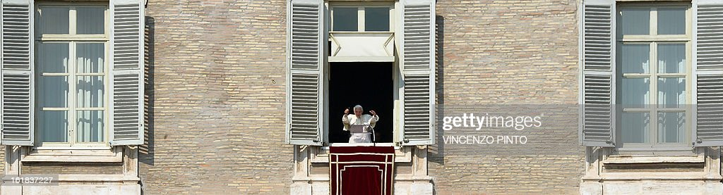Pope Benedict XVI leads the Angelus prayer from the window of his appartmnents on February 17, 2013 at the Vatican. The Vatican the day before said it could speed up the election of a new pope as lobbying for Benedict XVI's job intensified amid speculation over who had the best chance to succeed him. AFP PHOTO / VINCENZO PINTO