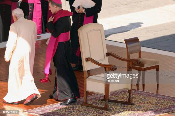 Pope Benedict XVI leaves the dias in St Peter's Square at the end of his weekly public audience on February 27 2013 in Vatican City Vatican The...