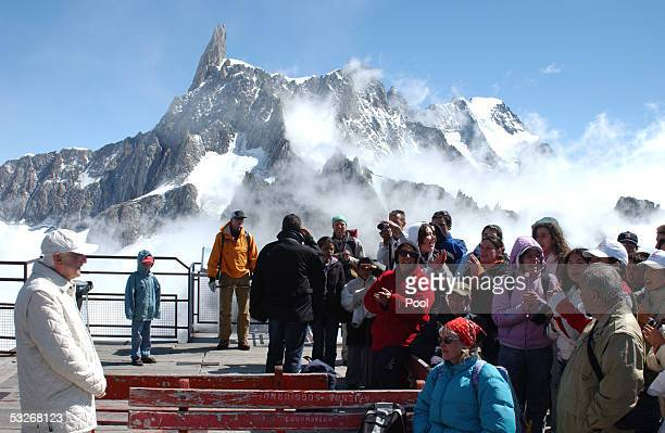 Pope Benedict XVI looks at the tourists during an excursion on Mt Blanc July 21 2005 in Aosta Valley northern Italy