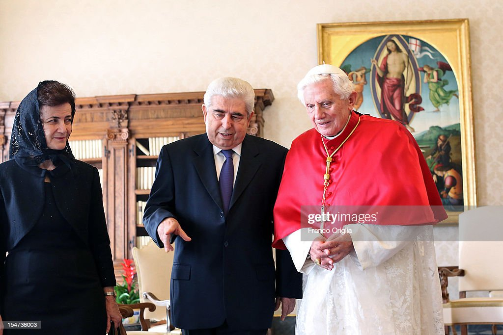 <a gi-track='captionPersonalityLinkClicked' href=/galleries/search?phrase=Pope+Benedict+XVI&family=editorial&specificpeople=201771 ng-click='$event.stopPropagation()'>Pope Benedict XVI</a> (R) meets Cyprus President Demetris Christofias (C) and his wife Elsie Christofia (L) at his private studio on October 25, 2012 in Vatican City, Vatican. The President and his wife are on a one day official visit to the Vatican.