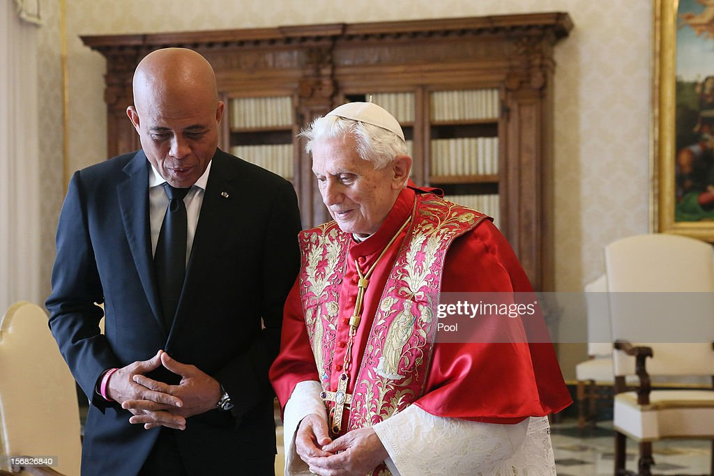 <a gi-track='captionPersonalityLinkClicked' href=/galleries/search?phrase=Pope+Benedict+XVI&family=editorial&specificpeople=201771 ng-click='$event.stopPropagation()'>Pope Benedict XVI</a> meets Haitian President <a gi-track='captionPersonalityLinkClicked' href=/galleries/search?phrase=Michel+Martelly&family=editorial&specificpeople=7130974 ng-click='$event.stopPropagation()'>Michel Martelly</a> at his private library on November 22, 2012 in Vatican City, Vatican. President Martelly is concluding his European tour today.