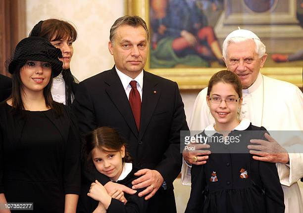 Pope Benedict XVI meets with Hungary's Prime Minister Viktor Orban his wife Aniko Levai and their children at his private library on December 6 2010...