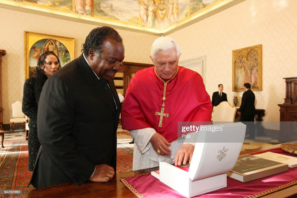 <a gi-track='captionPersonalityLinkClicked' href=/galleries/search?phrase=Pope+Benedict+XVI&family=editorial&specificpeople=201771 ng-click='$event.stopPropagation()'>Pope Benedict XVI</a> meets with President of Gabon <a gi-track='captionPersonalityLinkClicked' href=/galleries/search?phrase=Ali+Bongo+Ondimba&family=editorial&specificpeople=6166342 ng-click='$event.stopPropagation()'>Ali Bongo Ondimba</a> and his wife on December 10, 2009 in Vatican City, Vatican.