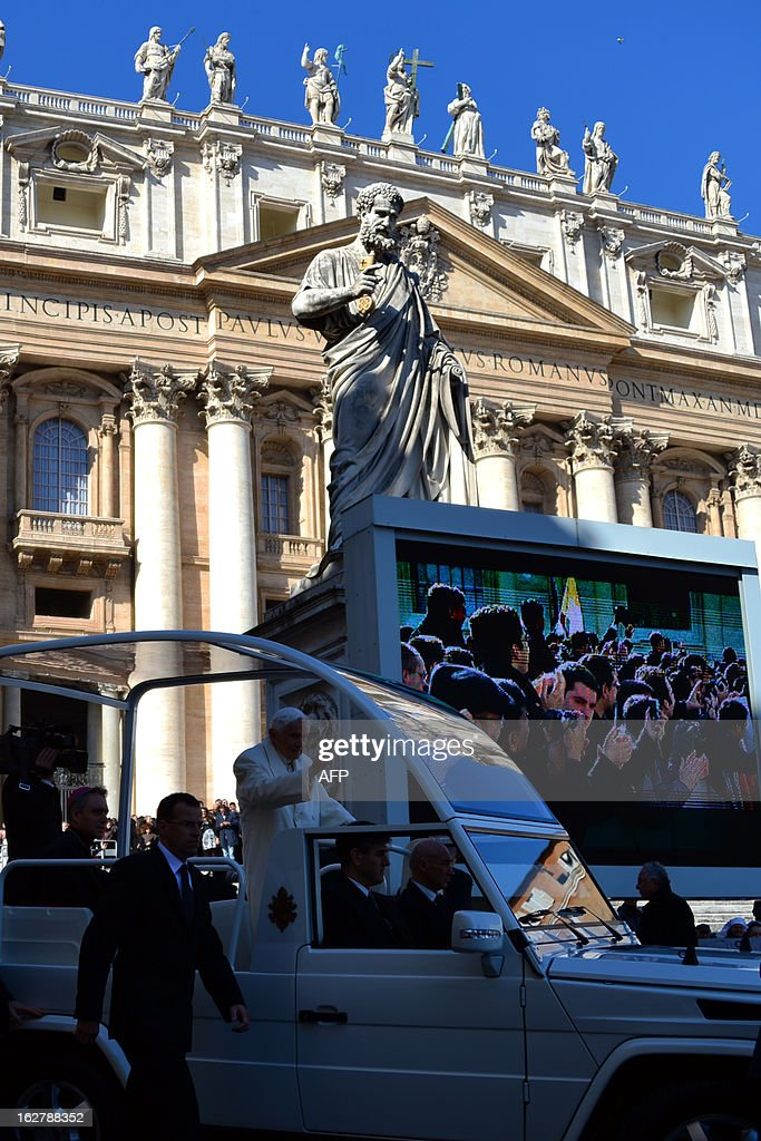 Pope Benedict XVI passes by the statue of St Peter as he arrives for his last weekly audience on February 27, 2013 on St Peter's square at the Vatican. Pope Benedict XVI will hold the last audience of his pontificate in St Peter's Square on Wednesday on the eve of his historic resignation as leader of the world's 1.2 billion Catholics.