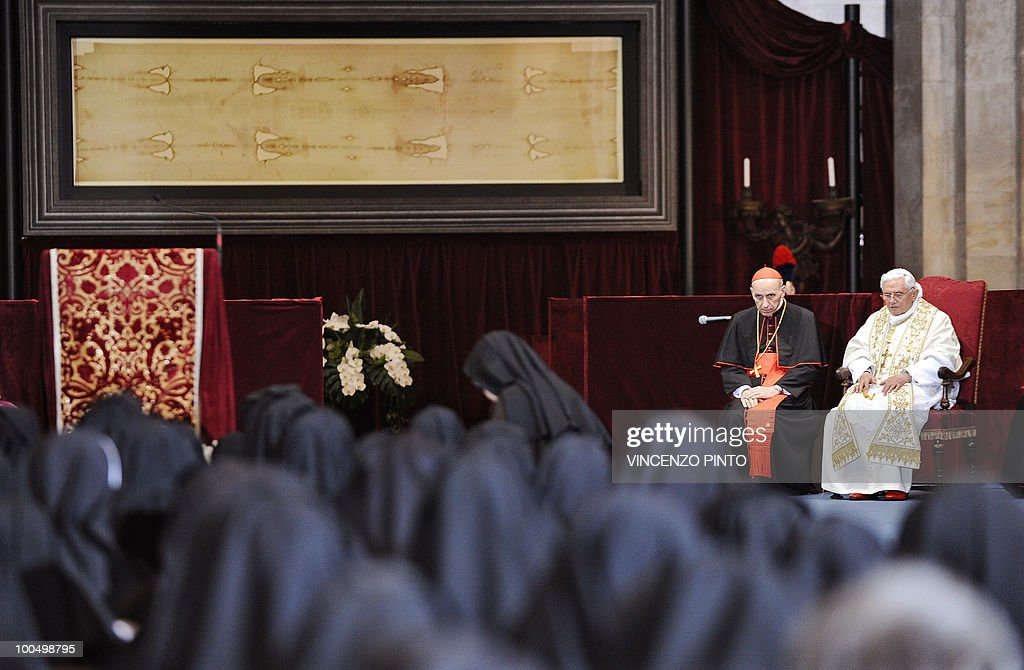 Pope Benedict XVI prays in front of the Shroud in the Turin cathedral on May 2, 2010. Pope Benedict XVI will bow before the Shroud of Turin, the object of both bafflement and veneration believed by many to be the burial cloth of Jesus Christ. 'It will be a propitious occasion to contemplate this mysterious visage that speaks silently to the heart of men, inviting them to recognise the face of God,' Benedict said in 2008 as he announced the planned new exposition of the mysterious cloth. The 83-year-old pontiff, in his one day visit in Turin, will celebrate an open-air mass in Piazza San Carlo next to the Turin Cathedral housing the shroud, meetings with youths and a visit to a centre for severely handicapped people.