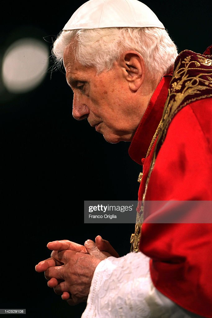 <a gi-track='captionPersonalityLinkClicked' href=/galleries/search?phrase=Pope+Benedict+XVI&family=editorial&specificpeople=201771 ng-click='$event.stopPropagation()'>Pope Benedict XVI</a> presides over the Way Of The Cross procession at the Colosseum on Good Friday April 6, 2012 in Rome, Italy. The traditional Catholic procession on Good Friday recalls the crucifixion of Jesus Christ ahead of Sunday's Easter holiday.