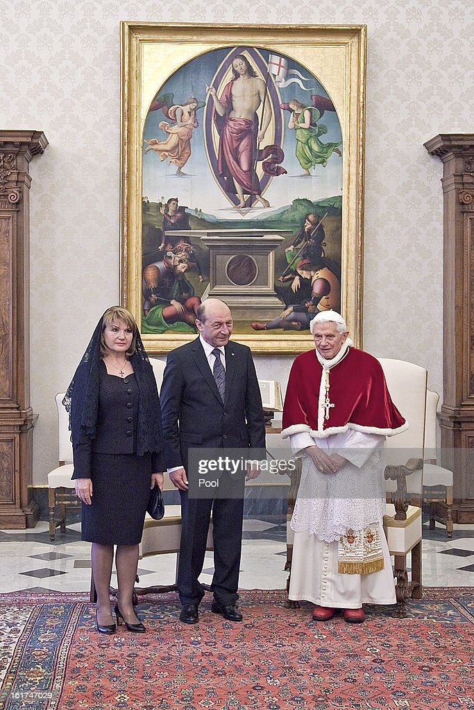 <a gi-track='captionPersonalityLinkClicked' href=/galleries/search?phrase=Pope+Benedict+XVI&family=editorial&specificpeople=201771 ng-click='$event.stopPropagation()'>Pope Benedict XVI</a> receives President of Romania <a gi-track='captionPersonalityLinkClicked' href=/galleries/search?phrase=Traian+Basescu&family=editorial&specificpeople=542324 ng-click='$event.stopPropagation()'>Traian Basescu</a> and his wife Maria Basescu at his private library on February 15, 2013 in Vatican City, Vatican.