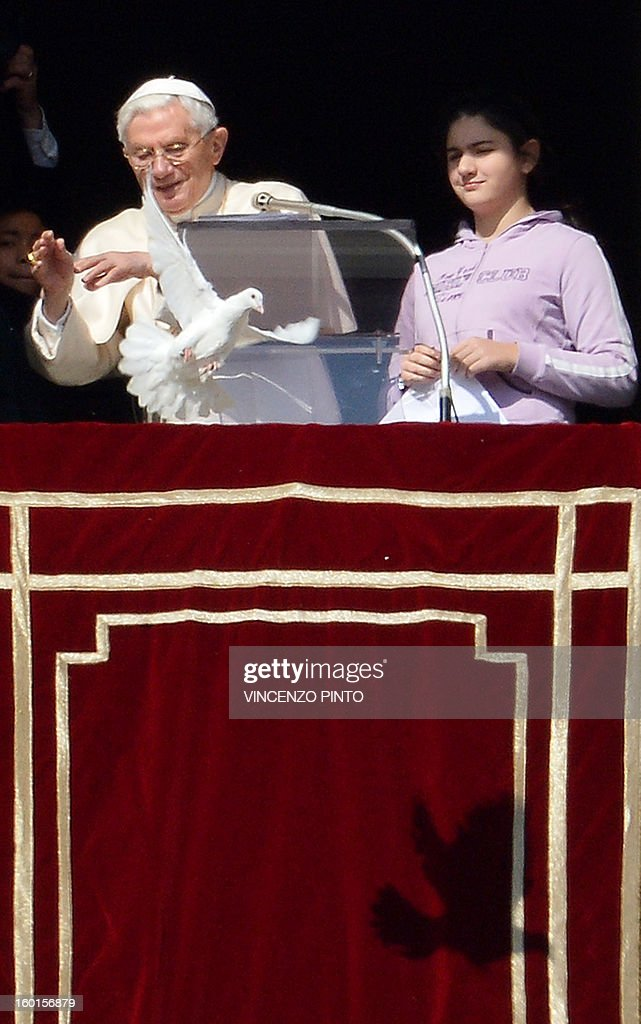 Pope Benedict XVI releases a dove from the window of his appartment at the end of his Sunday Angelus prayer in St. Peter's square at the Vatican on January 27, 2013. The Pontiff and youth of the Catholic Action released two doves, symbol of peace.