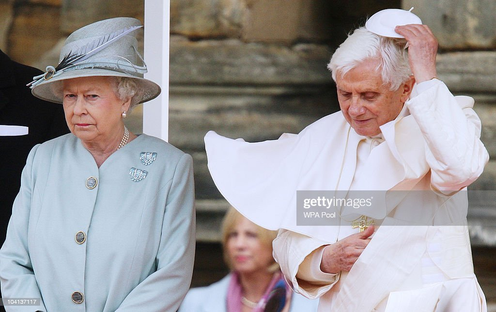 Pope Benedict XVI (R) replaces his zucchetto as he meets with Queen Elizabeth II during day one of his four day state visit to the United Kingdom at Holyrood House on September 16, 2010 in Edinburgh, Scotland. Pope Benedict XVI is conducting the first state visit to the UK by a Pontiff. During the four day visit Pope Benedict will celebrate mass, conduct a prayer vigil as well as beatify Cardinal Newman at an open air mass in Cofton Park . His Holiness will meet The Queen as well as political and religious representatives.