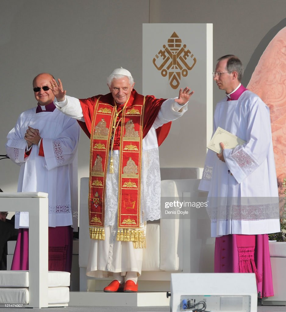 <a gi-track='captionPersonalityLinkClicked' href=/galleries/search?phrase=Pope+Benedict+XVI&family=editorial&specificpeople=201771 ng-click='$event.stopPropagation()'>Pope Benedict XVI</a> salutes pilgrims at Cibeles square during a via crucis at World Youth Day 2011 celebrations on August 19, 2011 in Madrid, Spain. Initiated by Pope John Paul II in 1985, World Youth Day youth-oriented events for the celebration of the Catholic faith are held every three years in a different country; this time in Madrid from August 16th to 21st, with <a gi-track='captionPersonalityLinkClicked' href=/galleries/search?phrase=Pope+Benedict+XVI&family=editorial&specificpeople=201771 ng-click='$event.stopPropagation()'>Pope Benedict XVI</a> in attendance.
