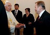 Pope Benedict XVI shakes hand with former Czech President Vaclav Havel before the concert by the Czech Philharmonic Orchestra at Prague Castle on...