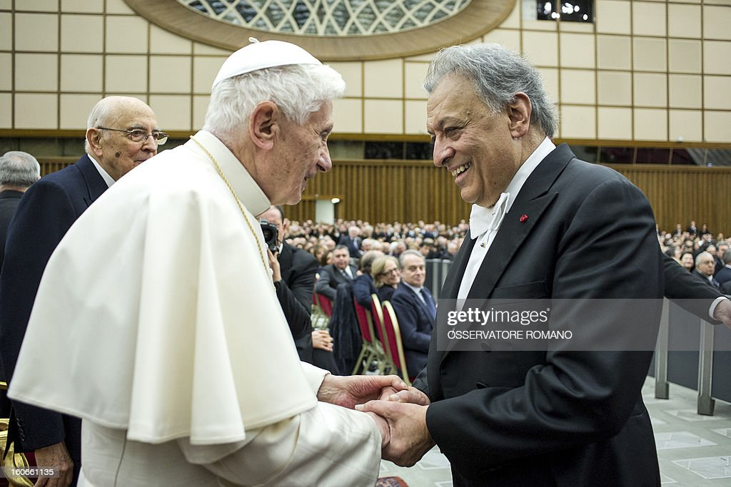 CREDIT 'AFP PHOTO / OSSERVATORE ROMANO' - NO MARKETING NO ADVERTISING CAMPAIGNS - DISTRIBUTED AS A SERVICE TO CLIENTS Pope Benedict XVI (L)shakes hands with Indian conductor Zubin Metha, at the end of a concert by the Orchestra del Maggio Fiorentino, to celebrate the 84th Lateran pact's anniversary on February 4, 2013, at the Sala Nervi in Vatican city.