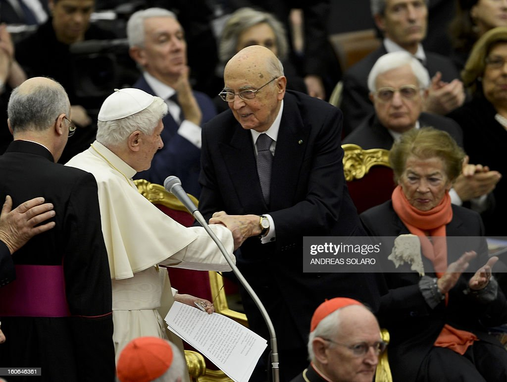 Pope Benedict XVI (L) shakes hands with Italy's president Giorgio Napolitano (C) after a concert by the Orchestra del Maggio Fiorentino, directed by Indian conductor Zubin Metha, to celebrate the 84th Lateran pact's anniversary on February 4, 2013, at the Sala Nervi in Vatican city.