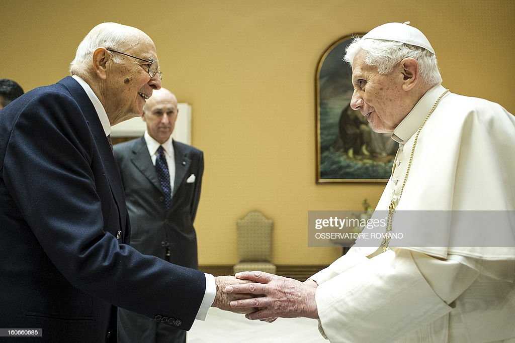 CREDIT 'AFP PHOTO / OSSERVATORE ROMANO' - NO MARKETING NO ADVERTISING CAMPAIGNS - DISTRIBUTED AS A SERVICE TO CLIENTS Pope Benedict XVI (R) shakes hands with Italy's president Giorgio Napolitano in a private room as they attend the concert by the Orchestra del Maggio Fiorentino, directed by Indian conductor Zubin Metha, to celebrate the 84th Lateran pact's anniversary on February 4, 2013, in Vatican city.