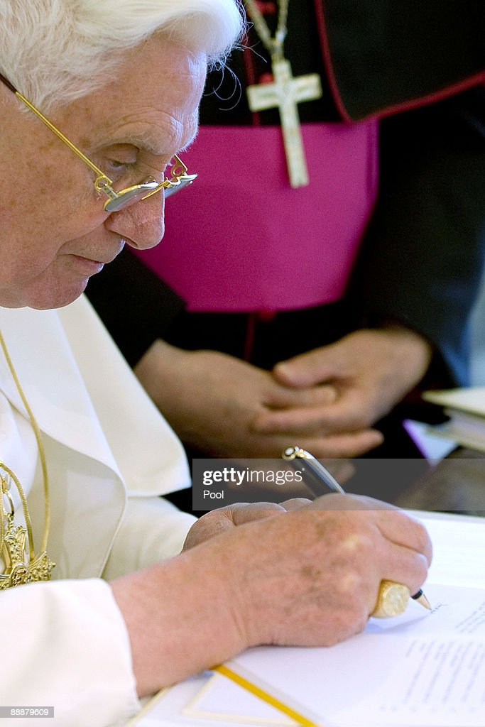 pope benedict xvi signs his new encyclical letter caritas in veritate at his studio on july